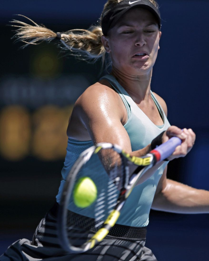 Eugenie Bouchard of Canada makes a forehand return to Ana Ivanovic of Serbia during their quarterfinal at the Australian Open tennis championship in Melbourne, Australia, Tuesday, Jan. 21, 2014. (AP Photo/Rick Rycroft)