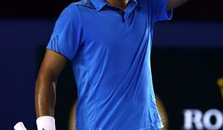 Jo-Wilfried Tsonga of France reacts after losing a point during his fourth round match against Roger Federer of Switzerland at the Australian Open tennis championship in Melbourne, Australia, Monday, Jan. 20, 2014. (AP Photo/Aaron Favila)