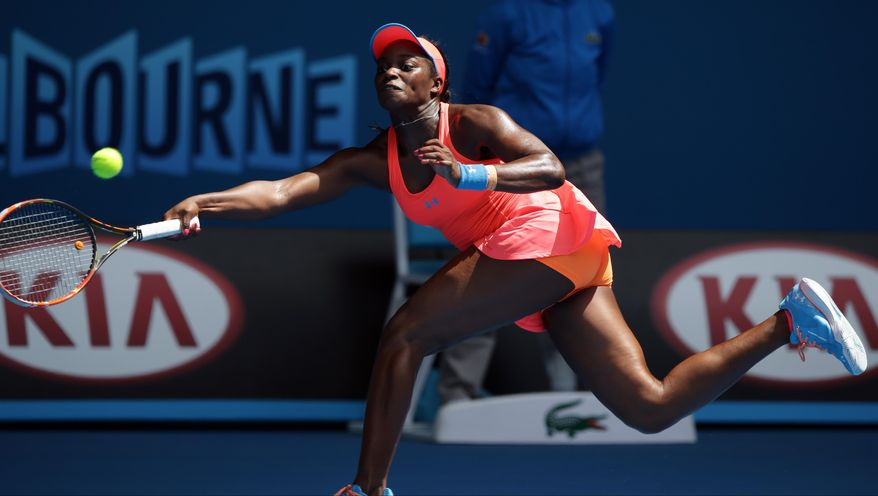 Sloane Stephens of the U.S. makes a forehand return to Victoria Azarenka of Belarus during their fourth round match at the Australian Open tennis championship in Melbourne, Australia, Monday, Jan. 20, 2014. (AP Photo/Aaron Favila)