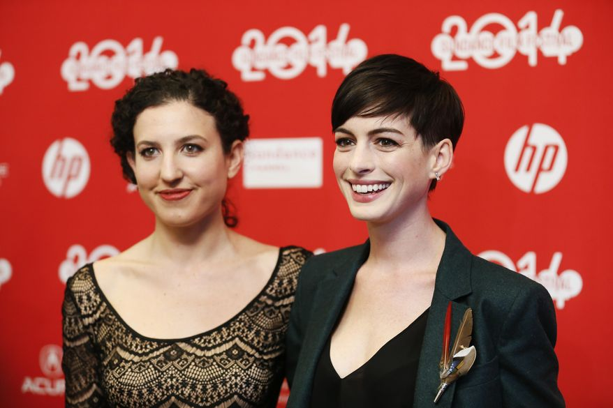 """Writer and director Kate Barker-Froyland, left, and cast member Anne Hathaway, right, pose together at the premiere of the film """"Song One"""" during the 2014 Sundance Film Festival, on Monday, Jan. 20, 2014, in Park City, Utah. (Photo by Danny Moloshok/Invision/AP)"""