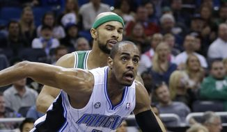 Orlando Magic's Arron Afflalo (4) and Boston Celtics' Jerryd Bayless go after a loose ball during the first half of an NBA basketball game in Orlando, Fla., Sunday, Jan. 19, 2014. (AP Photo/John Raoux)
