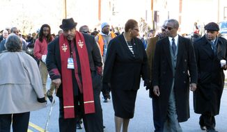 North Carolina NAACP President William Barber, left, interim national  NAACP President Lorraine Miller, center, and South Carolina NAACP President Lonnie Randolph, right, march to the South Carolina Statehouse as part of the King Day at the Dome rally on Monday, Jan. 20, 2014, in Columbia, S.C. (AP Photo/Jeffrey Collins)