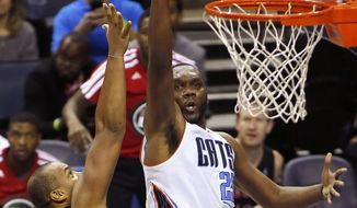 Charlotte Bobcats center Al Jefferson, right, shoots over Toronto Raptors forward Chuck Hayes in the second half of an NBA basketball game, Monday, Jan. 20, 2014, in Charlotte, N.C. Charlotte won 100-95. (AP Photo/Nell Redmond)