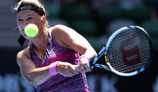 Victoria Azarenka of Belarus makes a backhand return to Sloane Stephens of the U.S. during their fourth round match at the Australian Open tennis championship in Melbourne, Australia, Monday, Jan. 20, 2014.(AP Photo/Aaron Favila)