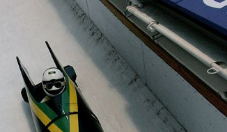 Jamaica's Winston Watt takes turn 12 by himself during the America's Cup bobsled race Monday, Dec. 6, 2004, in Park City, Utah. Watt's brakeman, Garnet Jones, fell at the start and failed to hop into the sled. The event was held at the Utah Olympic Park, venue for the 2002 Winter Games. (AP Photo/Douglas C. Pizac)