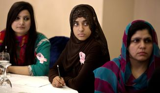 In this Wednesday, Oct. 30, 2013 photo, Pakistani women listen to a lecture organized by the breast cancer awareness group PinkRibbon in Islamabad, Pakistan. One in nine women in Pakistan will face breast cancer during their life, with the country itself having the highest rate of the disease across Asia, according to the breast cancer awareness group PinkRibbon, oncologists and other aid groups. Yet discussing it remains taboo in a conservative, Islamic culture where the word breast is associated with sexuality instead of health and many view it as immoral for women to go to the hospital for screenings or discuss it even within their family. (AP Photo/B.K. Bangash)