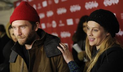 """FILE - In this Sunday, Jan. 19, 2014 file photo, Mark Webber, left, a cast member in """"Happy Christmas,"""" is joined by his wife, actress Teresa Palmer,"""" as he is interviewed at the premiere of the film at the 2014 Sundance Film Festival, in Park City, Utah. The sweetest couple around Sundance may be Webber and Palmer.  Webber, an actor, director and screenwriter, has two films, """"Laggies"""" and """"Happy Christmas,"""" premiering at the festival and wherever he goes, his pregnant wife has happily followed, snapping photos on her camera phone.  (Photo by Chris Pizzello/Invision/AP, File)"""