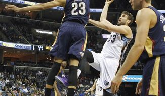 Memphis Grizzlies center Marc Gasol (33), of Spain, shoots against New Orleans Pelicans forward Anthony Davis (23) in the first half of an NBA basketball game, Monday, Jan. 20, 2014, in Memphis, Tenn. (AP Photo/Lance Murphey)