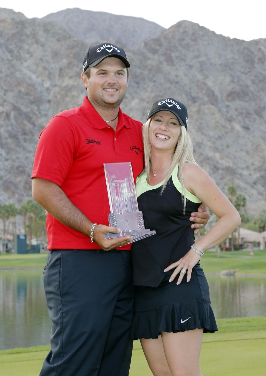 Patrick Reed, left, and wife Justine Reed pose with the trophy after the final round of the Humana Challenge PGA golf tournament on the Palmer Private course at PGA West, Sunday, Jan. 19, 2014, in La Quinta, Calif. (AP Photo/Matt York)