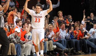 Virginia guard London Perrantes (23) celebrates a 3-point basket during the first half of an NCAA college basketball game against North Carolina, Monday, Jan. 20, 2014, in Charlottesville, Va. (AP Photo/Andrew Shurtleff)