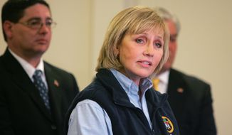 Lt. Gov. Kim Guadagno speaks to the press during the the Dr. Martin Luther King, Jr. National Day of Service in Union Beach, N.J., Monday, Jan. 20, 2014.   Guadagno denied allegations by the Hoboken mayor  that Superstorm Sandy relief funding was withheld from Hoboken because the mayor wouldn't sign off on a politically connected real estate venture.   (AP Photo/The Asbury Park Press, Tanya Breen)  NO SALES