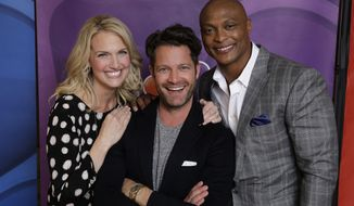 """This Jan. 19, 2014 photo shows, from left, Monica Pederson,, Nate Berkus, and Eddie George from """"American Dream Builders"""" at the NBCUniversal Press Tour, in Pasadena, Calif. George, a former NFL player, is turning a critical eye to home building and design as a judge on a new reality television show. He joins designer Berkus and interior decorator Pedersen on """"American Dream Builders"""" debuting March 23, 2014, on NBC. (AP Photo/NBC, Paul Drinkwater)"""