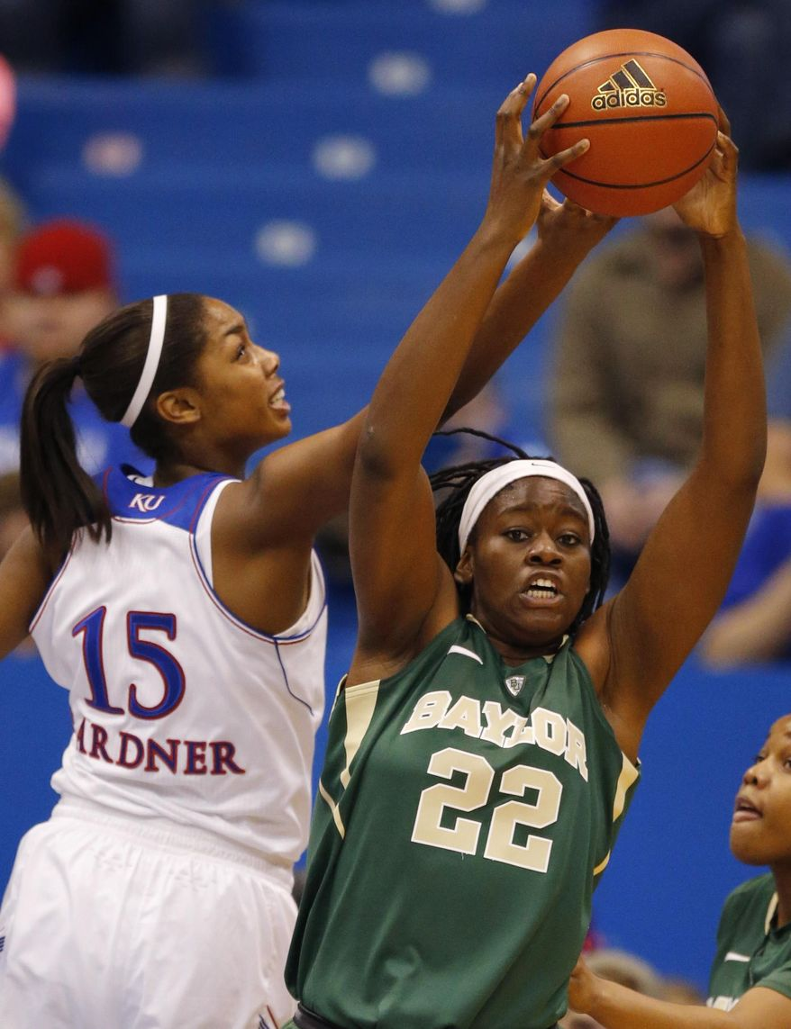 Baylor center Sune Agbuke (22) rebounds against Kansas forward Chelsea Gardner (15) during the first half of an NCAA college basketball game in Lawrence, Kan., Sunday, Jan. 19, 2014. (AP Photo/Orlin Wagner)