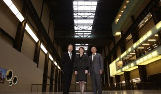 From left, Director of the Tate Modern Gallery, Nicholas Serota, Secretary of State for Culture, Media and Sport Maria Miller, and Euisun Chung, Vice Chairman of Hyundai Motor, pose,  during a photocall at the Tate Modern,  in London, Monday Jan. 20, 2013.  Autos will help fund art in a long-term sponsorship deal between Hyundai Motor Co. and Britain's Tate Modern gallery. Tate says the South Korean carmaker will fund commissions for the gallery's Turbine Hall until 2025. The first exhibition will open next year. Neither side disclosed the value of the deal. (AP Photo/PA, Yui Mok) UNITED KINGDOM OUT