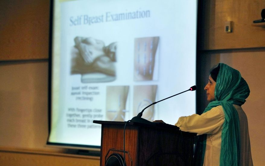 In this Wednesday, Oct. 30, 2013 photo, Pakistani doctor Erum Khan addresses female students during a lecture to promote awareness regarding breast cancer and its precautions at a university in Islamabad, Pakistan. One in nine women in Pakistan will face breast cancer during their life, with the country itself having the highest rate of the disease across Asia, according to the breast cancer awareness group PinkRibbon, oncologists and other aid groups. Yet discussing it remains taboo in a conservative, Islamic culture where the word breast is associated with sexuality instead of health and many view it as immoral for women to go to the hospital for screenings or discuss it even within their family. (AP Photo/Anjum Naveed)