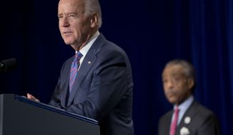 Vice President Joe Biden delivers the keynote address at the National Action Network's (NAN) Annual King Day breakfast convened by the Rev. Al Sharpton, right,  in Washington, Monday, Jan. 20, 2014. (AP Photo/Pablo Martinez Monsivais)