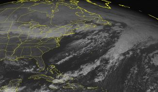 This NOAA satellite image taken Monday, Jan 20, 2014 at 01:45 PM EST shows cloudiness stretched from New England through the Mid Atlantic and Ohio Valley associated with a cold front moving eastward across the region. Snow, potentially heavy across the Appalachain mountains, will fall as this front moves eastward. Partly to mostly sunny skies continue across the southeastern United States.(AP Photo/Weather Underground)