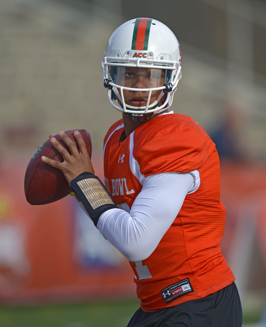 North Squad quarterback Stephen Morris of Miami (17) drops back during Senior Bowl practice at Ladd-Peebles Stadium, Monday, Jan. 20, 2014,  in Mobile, Ala.  (AP Photo/G.M. Andrews)