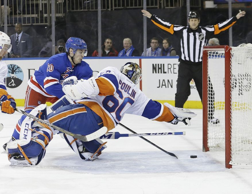 New York Rangers' Chris Kreider (20) shoots the puck past New York Islanders goalie Kevin Poulin (60) during the second period of an NHL hockey game, Tuesday, Jan. 21, 2014, in New York. (AP Photo/Frank Franklin II)