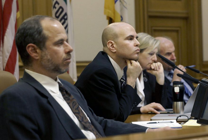 San Francisco Municipal Transportation Authority board of directors Edward D. Reiskin, director of transportation, from left, Joel Ramos, Cheryl Brinkman, vice chairman, and Tom Nolan, chairman, listen to speakers at a SFMTA meeting at City Hall in San Francisco, Tuesday, Jan. 21, 2014. San Francisco officials voted in favor of a proposal to start regulating employee shuttles for companies like Google, Facebook and Apple, charging a fee for those that use public bus stops and controlling where they load and unload. Private shuttle buses have created traffic problems, blocking public bus stops during peak commute hours. (AP Photo/Jeff Chiu)