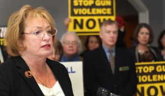 State Rep. Elaine Andrews-Ahearn speaks  during a news conference on a bill that would expand gun background checks in New Hampshire. , Tuesday, Jan. 21, 2014 in Concord, N.H. (AP Photo/Jim Cole)
