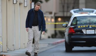 Law enforcement officers investigate the accidental fatal shooting of a Bay Area Rapid Transit police officer by a fellow BART officer while serving a warrant at an apartment building, according to officials, Tuesday, Jan. 21, 2014, in Dublin, Calif. (AP Photo/The Contra Costa Times, Dan Honda)