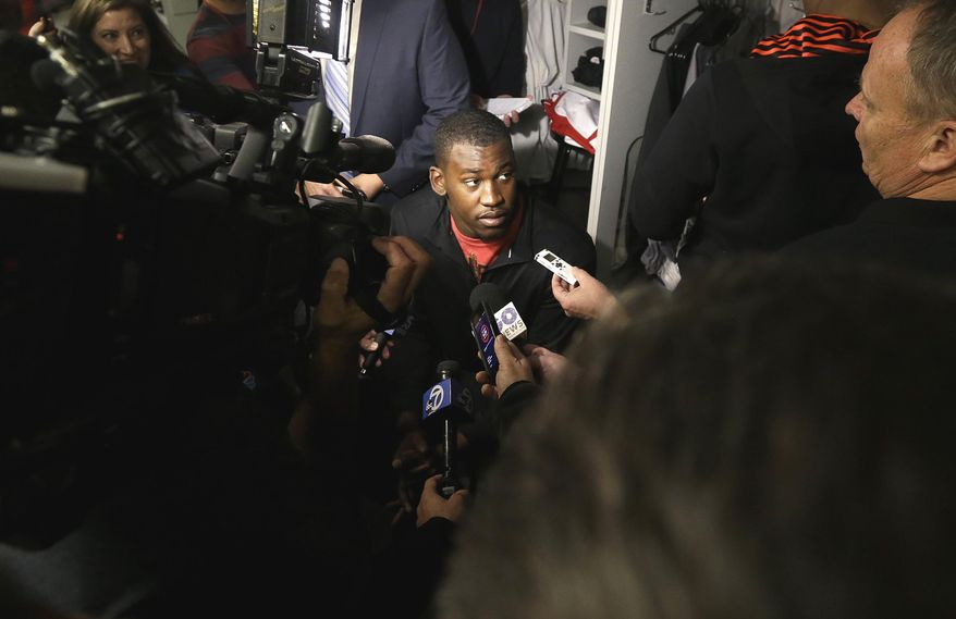 San Francisco 49ers linebacker Aldon Smith answers questions from reporters in the locker room at an NFL training facility in Santa Clara, Calif., Monday, Jan. 20, 2014. The 49ers lost to the Seattle Seahawks in the NFC Championship Game. (AP Photo/Jeff Chiu)