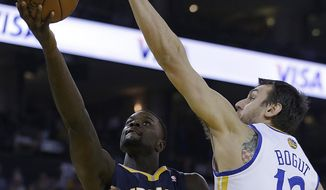 Indiana Pacers' Lance Stephenson, left, lays up a shot against Golden State Warriors' Andrew Bogut (12) during the first half of an NBA basketball game, Monday, Jan. 20, 2014, in Oakland, Calif. (AP Photo/Ben Margot)