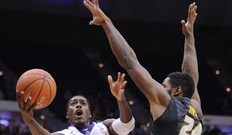 LSU's Shavon Coleman (5) is fouled by Missouri's Torren Jones (24) during an NCAA college basketball game on Tuesday, Jan. 21, 2014, in Baton Rouge, La. LSU won 77-71. (AP Photo/The Times-Picayune, Hilary Scheinuk) MAGS OUT; NO SALES; USA TODAY OUT; THE BATON ROUGE ADVOCATE OUT