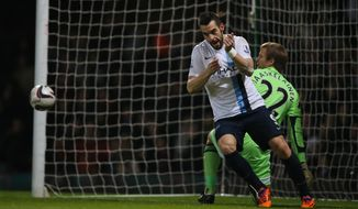 Manchester City's Alvaro Negredo turns away to celebrate after scoring the opening goal during the second leg of the English  League Cup semifinal soccer match between West Ham United and Manchester City at the Boleyn stadium in London, Tuesday, Jan 21  2014.(AP Photo/Alastair Grant)
