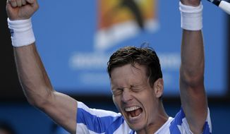 Tomas Berdych of the Czech Republic celebrates after defeating David Ferrer of Spain during their quarterfinal at the Australian Open tennis championship in Melbourne, Australia, Tuesday, Jan. 21, 2014.(AP Photo/Rick Rycroft)