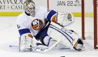 New York Islanders goalie Kevin Poulin (60) stops a shot on the goal during the second period of an NHL hockey game against the New York Rangers, Tuesday, Jan. 21, 2014, in New York. (AP Photo/Frank Franklin II)