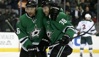 Dallas Stars' Trevor Daley (6) congratulates center Vernon Fiddler (38) on his goal against the Minnesota Wild in the first period of an NHL hockey game, Tuesday, Jan. 21, 2014, in Dallas. (AP Photo/Tony Gutierrez)