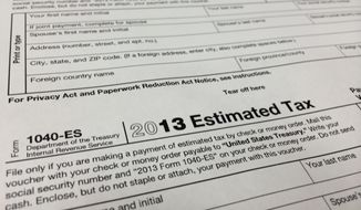 This Thursday, Jan. 9, 2013, photo, shows a 2013 1040-ES IRS Estimated Tax form at H&R Block tax preparation office in the Echo Park district of Los Angeles. (AP Photo/Damian Dovarganes) ** FILE **