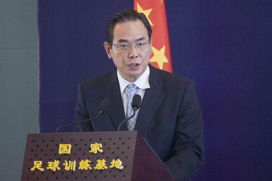 Cai Zhenhua, deputy Director of State General Administration of Sports, speaks at the 10th congress of Chinese Football Association in Beijing, China, Monday Jan. 21, 2014. The former Chinese national table tennis coach has been named head of the national football association in the latest bid to revive the country's dismal performance in the sport. (AP Photo)  CHINA OUT