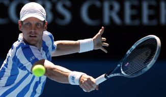 Tomas Berdych of the Czech Republic makes a backhand return to David Ferrer of Spain during their quarterfinal at the Australian Open tennis championship in Melbourne, Australia, Tuesday, Jan. 21, 2014.(AP Photo/Aaron Favila)