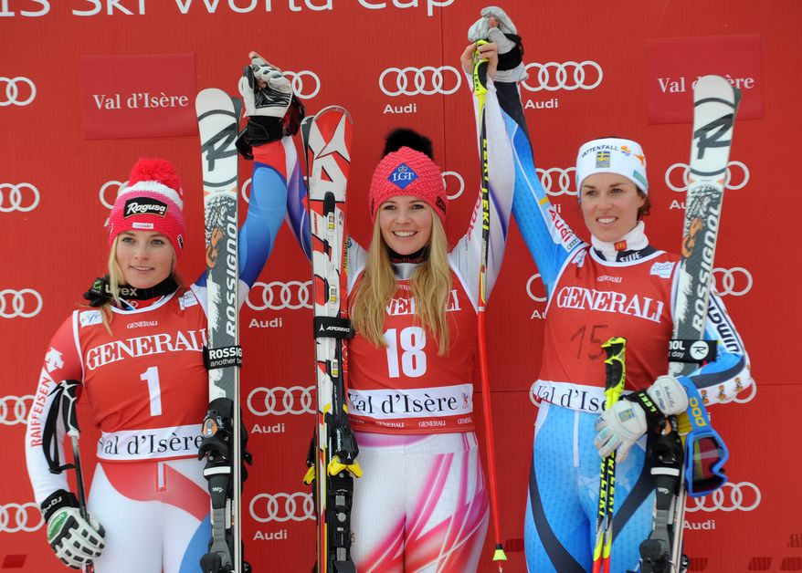 Liechtenstein's Tina Weirather, center, winner of an alpine ski women's World Cup giant slalom, celebrates on the podium with second-placed Switzerland's Lara Gut, left, and third-placed Sweden's Maria Pietilae-Holmner, in Val D'Isere, France, Sunday, Dec. 22, 2013. (AP Photo/Marco Tacca)
