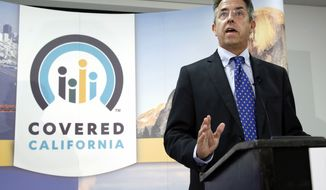 ** FILE ** In this Nov. 13, 2013 file photo, Peter Lee, executive director of Covered California, the state's health insurance exchange, announces that sign-ups have accelerated in November for health insurance during the first month of open enrollment during a news conference in Sacramento, Calif.  (AP Photo/Rich Pedroncelli, File)