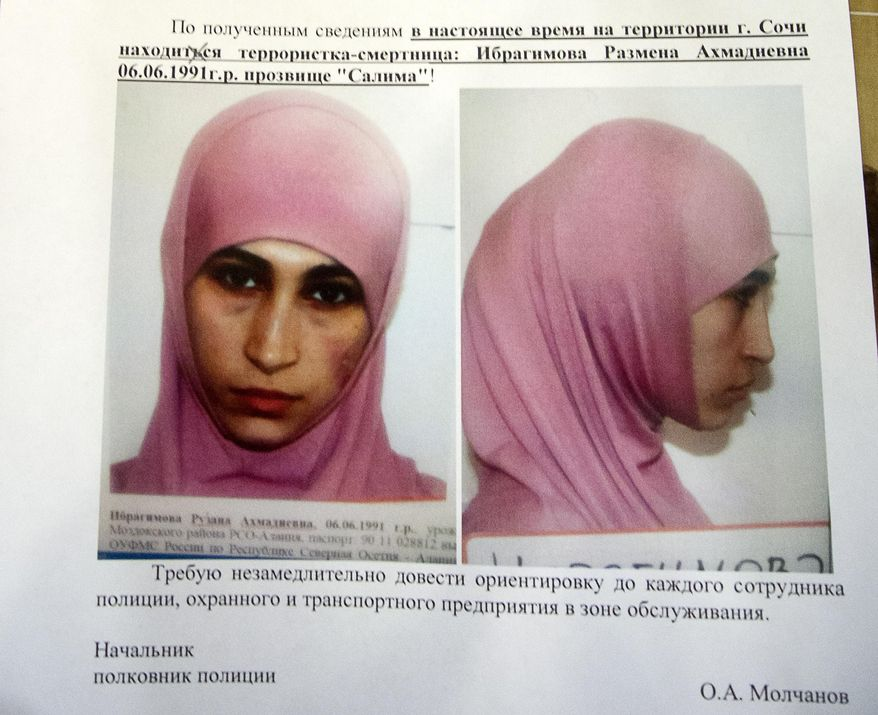 A photo of a police leaflet seen in a Sochi hotel on Tuesday, Jan. 21, 2014, shows Ruzanna Ibragimova and states that she is at large in the city of Sochi. Russian security officials are hunting down three potential female suicide bombers, one of whom is believed to be in Sochi, where the Winter Olympics will begin next month. Police leaflets seen by an Associated Press reporter at a central Sochi hotel on Tuesday contain warnings about three potential suicide bombers. Police said that Ruzanna Ibragimova, depicted in a mug shot wearing a pink hijab, was at large in Sochi. (AP Photo/Natalya Vasilyeva)