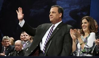 ** FILE ** In this Jan. 21, 2014, photo, New Jersey Gov. Chris Christie waves as he stands with his wife Mary Pat Christie during a gathering for his swearing in for his second term in Trenton, N.J. (AP Photo/Mel Evans)