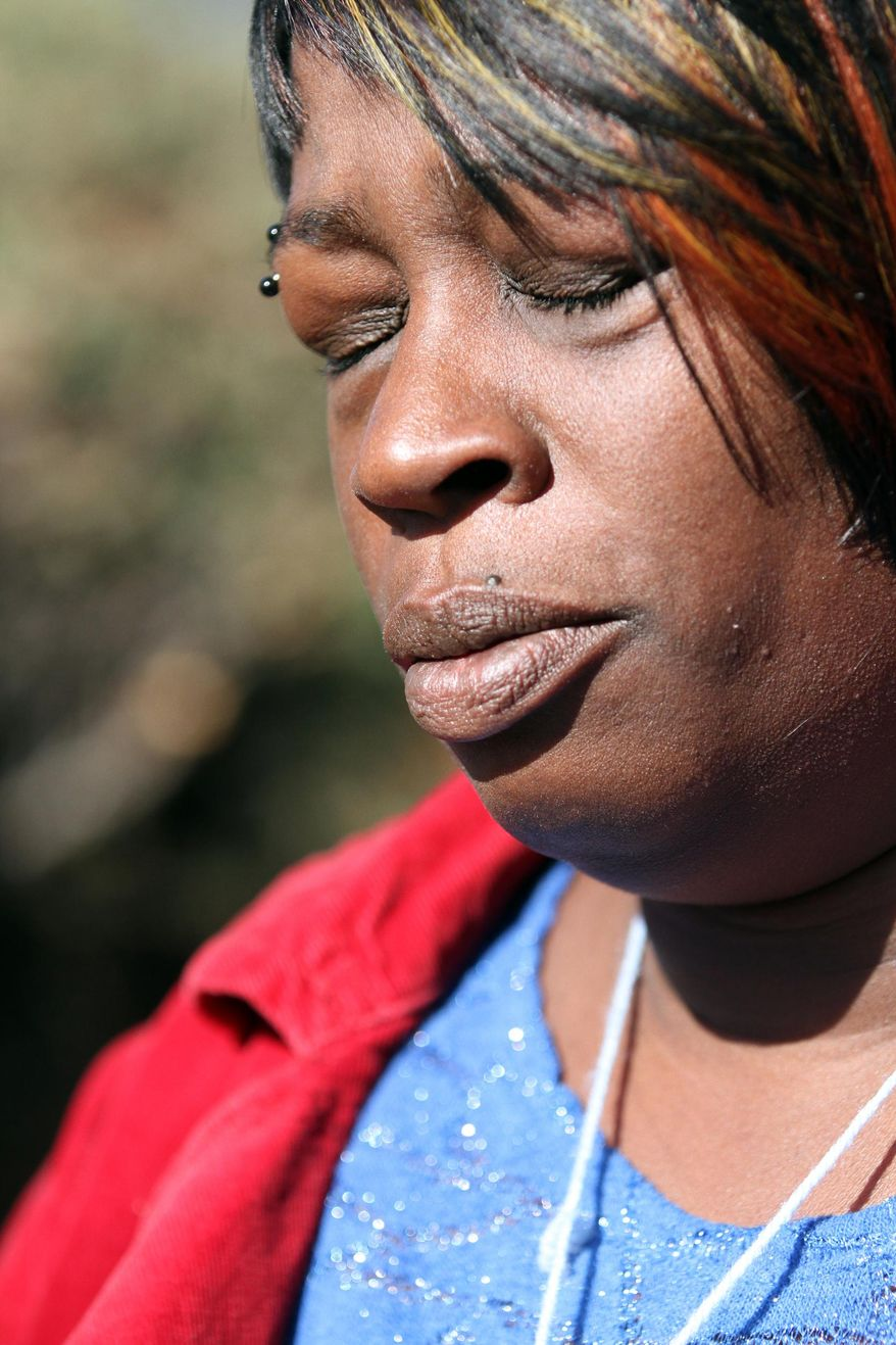 In this photo from Jan. 20, 2014, Dinyal New, mother of Lamar Broussard, 19, who was killed Sunday with his best friend Derryck Harris, 19, mourns the loss of the second son she has lost since New Year's Eve at home in Oakland, Calif. Lee Weathersby III, 13, New's other son, died on Jan. 1 after having been shot as he walked home from a New Year's Eve party.  (AP Photo/The Oakland Tribune, Laura A. Oda)
