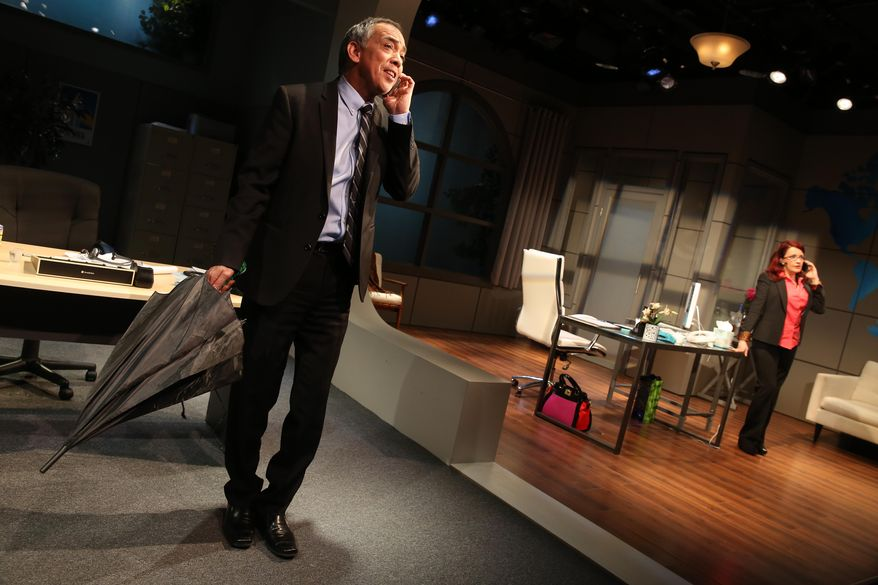"""This image released by Blake Zidell & Associates shows actors Thom Sesma, left, and Michele Ragusa portraying a pair of harried travel agents in """"Craving for Travel."""" The unusual production was funded by the travel industry but was written, acted and directed by folks with legitimate theater-world credentials. (AP Photo/Blake Zidell & Associates, Joan Marcus)"""