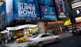 "Large signs advertising the Super Bowl are seen on 42nd Street by Times Square, Monday, Jan. 20, 2014, in New York. Preparations for fan venues and activities for the upcoming Super Bowl are starting to appear along several blocks of Broadway, part of which has been dubbed ""Super Bowl Boulevard"". (AP Photo/Craig Ruttle)"