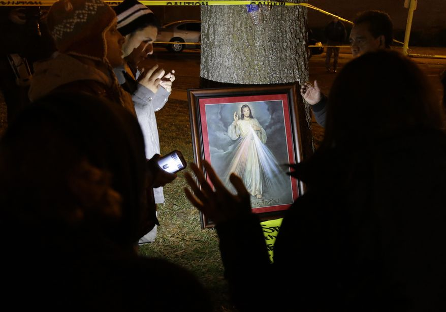 The family of condemned prisoner Edgar Tamayo prays after receiving word that the scheduled execution of the Mexican national would proceed Wednesday, Jan. 22, 2014, in Huntsville, Texas. Tamayo was convicted of killing a Houston police officer 20 years ago. (AP Photo/Pat Sullivan)