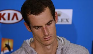 Andy Murray of Britain speaks during a press conference after his quarterfinal loss to Roger Federer of Switzerland at the Australian Open tennis championship in Melbourne, Australia, Wednesday, Jan. 22, 2014. (AP Photo/Aijaz Rahi)