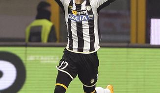 Udinese forward Nicolas Lopez, of Uruguay, celebrates after scoring during the Italian Cup soccer match between AC Milan and Udinese at the San Siro stadium in Milan, Italy, Wednesday, Jan. 22, 2014. (AP Photo/Antonio Calanni)