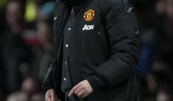 Manchester United's manager David Moyes issues instructions during his team's English League Cup semifinal second leg soccer match against Sunderland at Old Trafford Stadium, Manchester, England, Wednesday Jan. 22, 2014. (AP Photo/Jon Super)