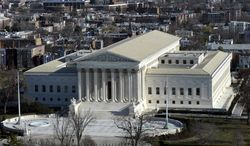FILE - This Dec. 19, 2013, file photo shows a view of the Supreme Court from near the top of the Capitol Dome on Capitol Hill, in Washington. The Supreme Court is hearing arguments in a case that asks whether a victim of child pornography can seek millions of dollars from a defendant who had just two images of her on his computer. The woman known only as Amy is trying to persuade the justices in arguments on Jan. 22, 2014, that people convicted of possessing child pornography should be held liable for the entire cost of the harm their victims suffer, including in psychiatric care, lost income and legal fees.  (AP Photo/Susan Walsh, File)