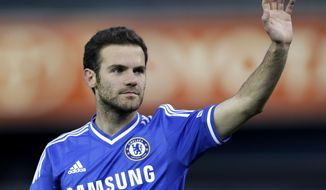 FILE - This is a Saturday, May 25, 2013, file photo of Chelsea modfielder Juan Mata gestures toward spectators at the end of an friendly soccer match against Manchester City at Yankee Stadium in New York. Mata is edging closer to joining Manchester United from Chelsea. In a sign that Mata's Chelsea exit is nearing, a person familiar with the situation says the midfielder didn't train with the first team on Wednesday Jan. 22, 2014.  (AP Photo/Julio Cortez, File)