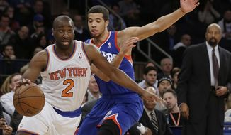 New York Knicks' Raymond Felton (2) drives past Philadelphia 76ers' Michael Carter-Williams (1) during the first half of an NBA basketball game, Wednesday, Jan. 22, 2014, in New York.  (AP Photo/Frank Franklin II)